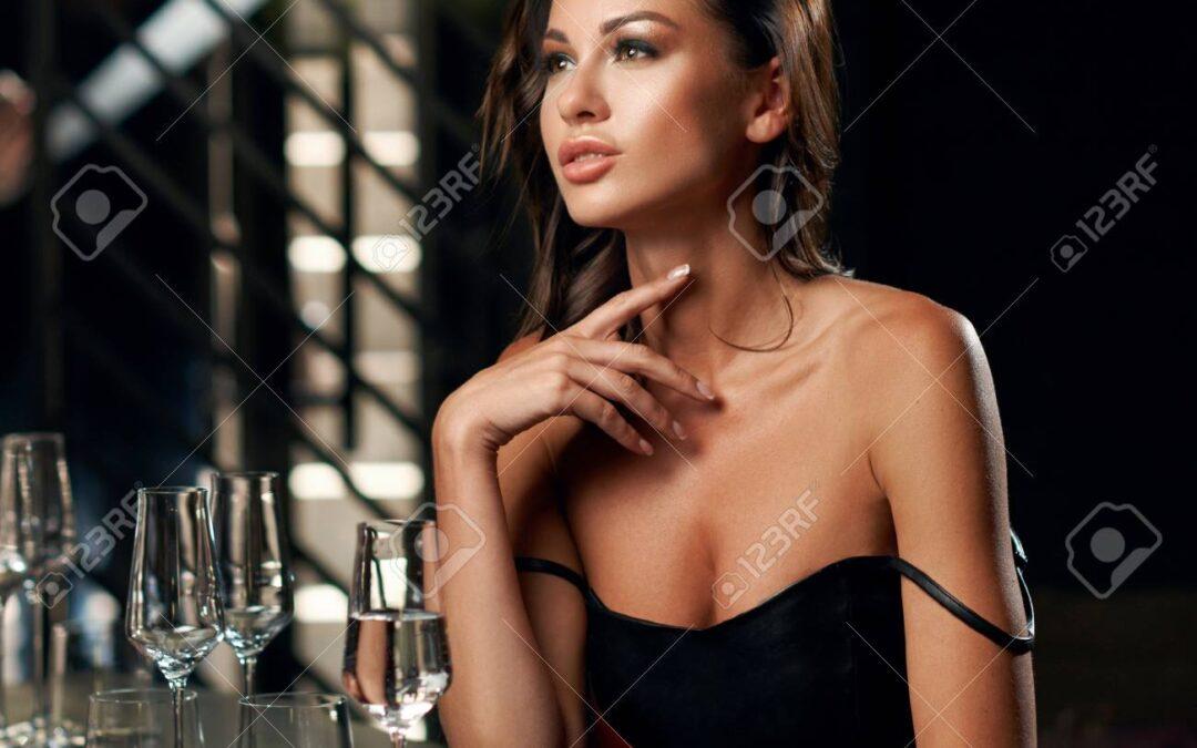 Beautiful escort in a restaurant