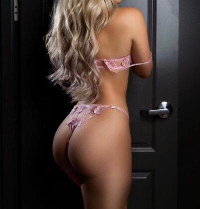 Sexy Escort Emily in pink lingerie